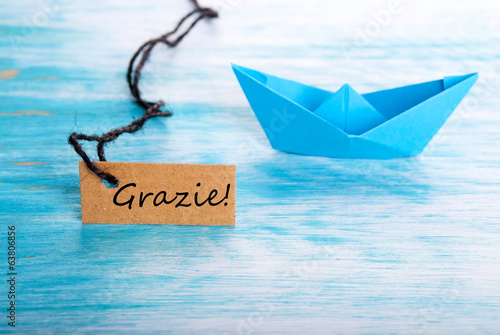 Label with Grazie and a Boat