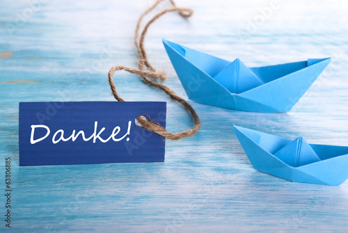 Label with Danke and a Boat