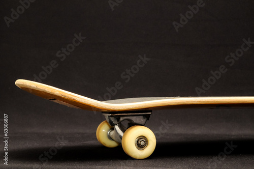 Old Used Wooden Skateboard