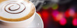 Coffee cup and saucer on bokeh background