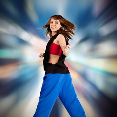 beautiful dancing girl on a bright background