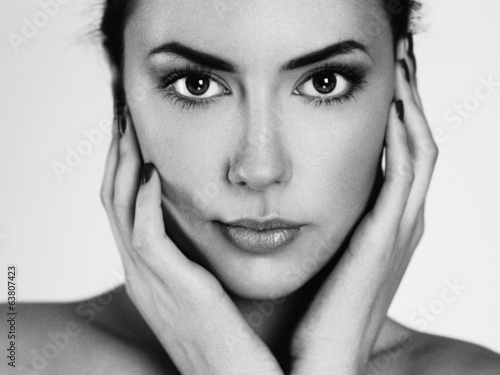 Black and white portrait of beautiful female with perfect skin