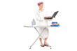 Girl holding laptop behind ironing board