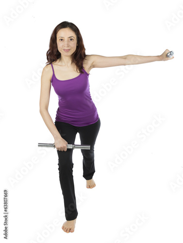 Fitness woman doing arm raising with weights