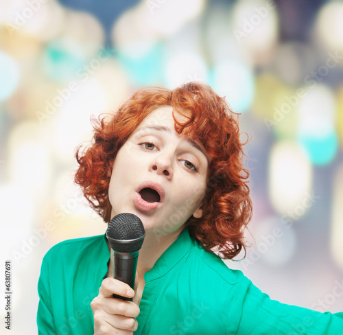 cute young woman singing into a microphone