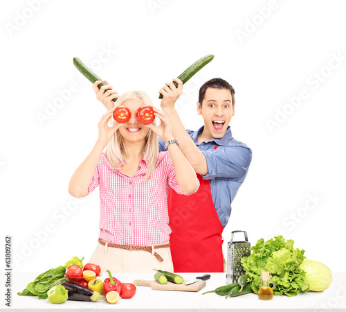 Young couple having fun while cooking