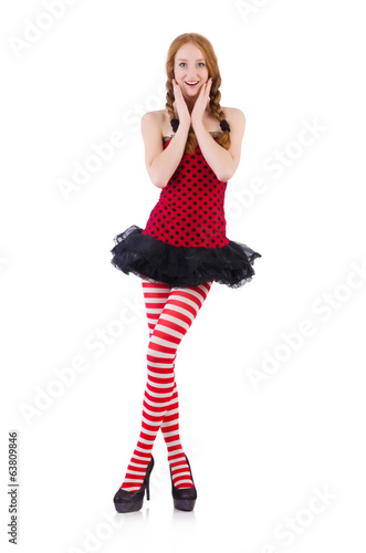 Redhead girl in red dress and stockings on white