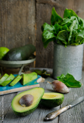 Fresh avocado on old wooden background