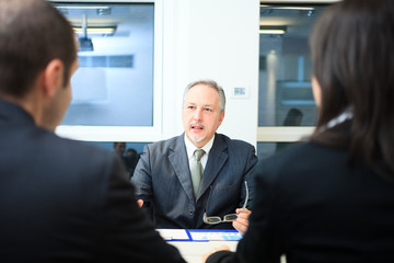Businessman talking to a couple
