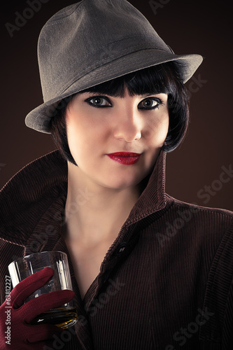 attractive female detective with a glass of whiskey