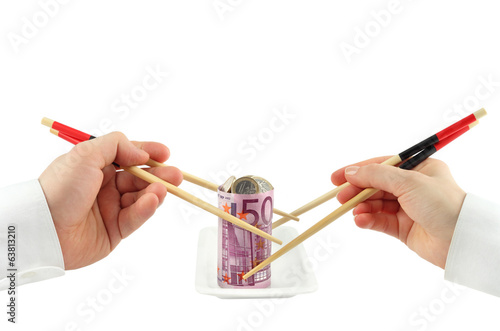 Hand taking a banknote as sushi on white background
