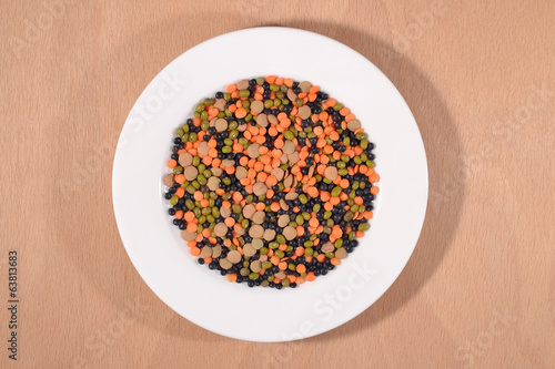 Mixture of lentils and beans on a white plate