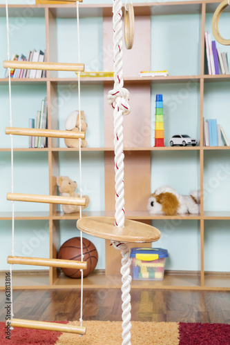 Sport rope against toys background.Interior of childrens room