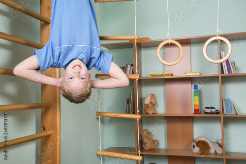 Boy plays in the children room