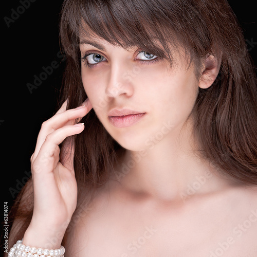Portrait of beautiful dark-haired girl