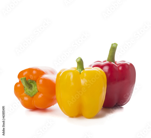 Sweet peppers, paprika on white, side view
