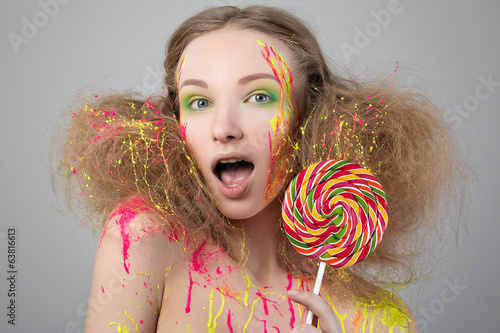 Beauty portrait of funny girl with lollipop