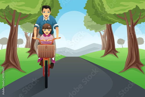 Dad daughter biking together
