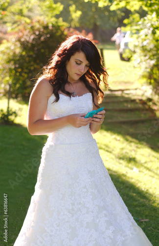 Bride texting on phone