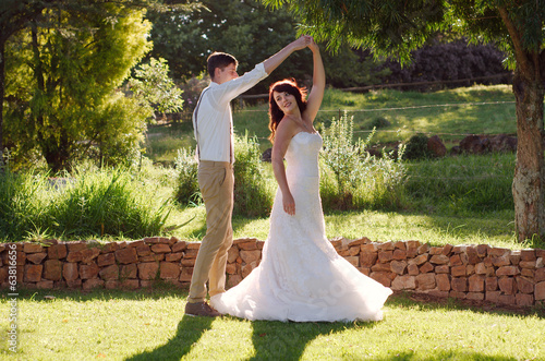 Bride and groom dancing in garden wedding