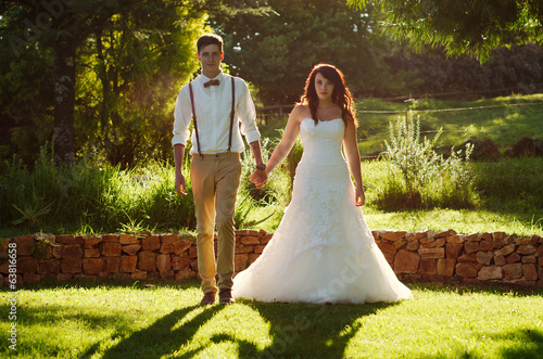 Bride and groom in garden wedding