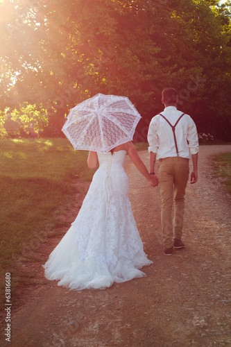 Bride and groom in walking off into the sunset
