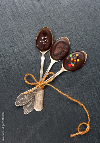 Chocolate Spoons. Chalk board background