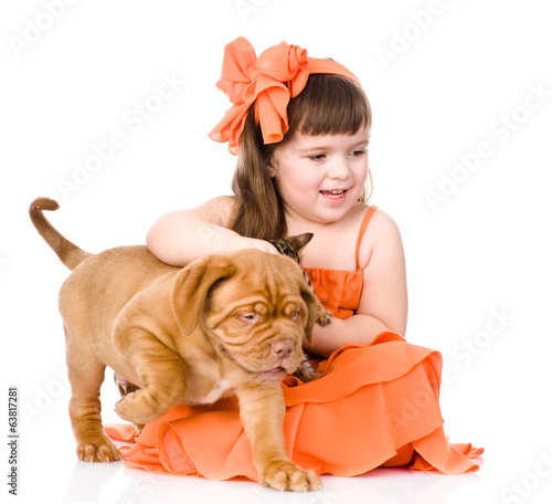 happy girl and her pets - a puppy and a kitten. isolated