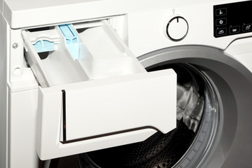 Close-up of detergent box in washing machine.