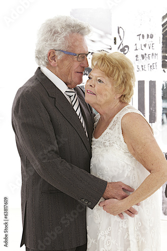 senior couple dressed up and dancing together with tenderness