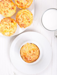 Top view of savory cheese and bacon muffins on the white table