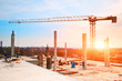 tower crane at construction site in morning sunlight - 63818065
