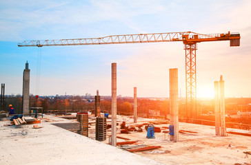 tower crane at construction site in morning sunlight