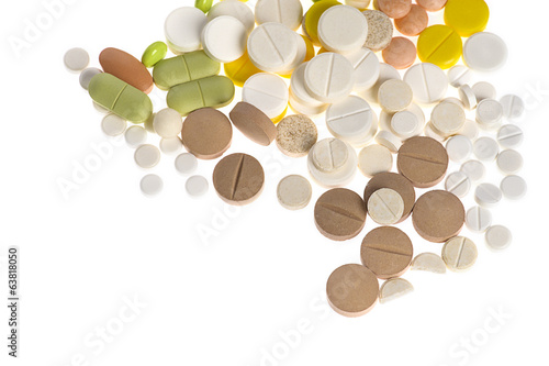 Stack of different pills isolated on white background