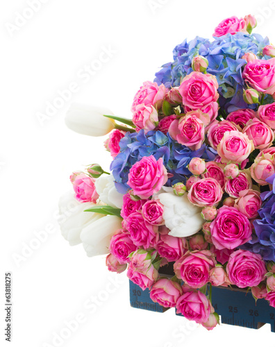 pile of white tulips, pink roses and blue hortensia flowers