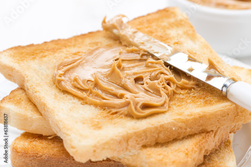 crispy toast with peanut butter, close-up