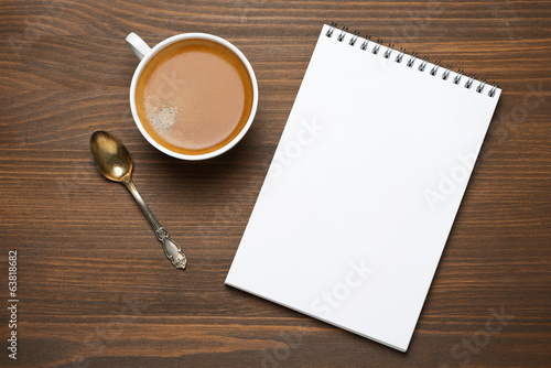 cup of espresso and note pad, concept photo, top view