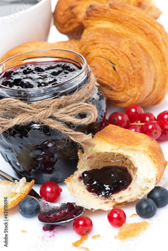 delicious breakfast with croissants and jam, close-up