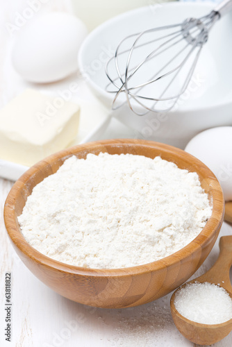 flour, salt, sugar, butter and eggs for baking