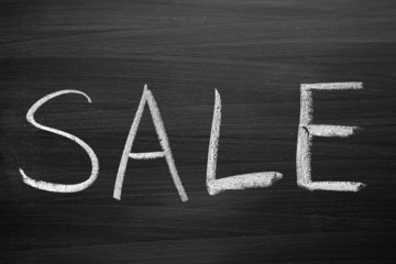 sale title written with a chalk on the blackboard