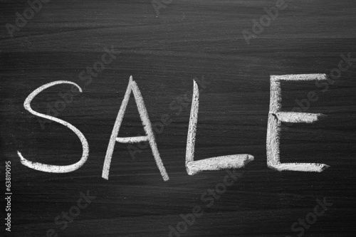 sale title written with a chalk on the blackboard