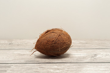 Coconuts close up on wooden board