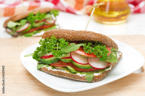 sandwich with cottage cheese, greens and vegetables, horizontal