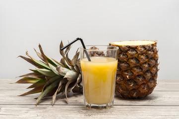 Half-cut pineapple on wooden board