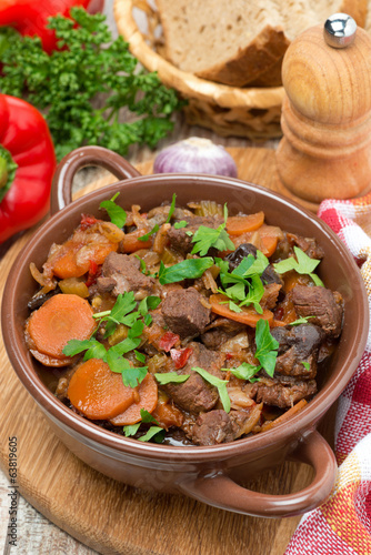 Stew with beef, prunes, vegetables and parsley, top view