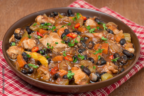 stew with black beans, chili, chicken and vegetables, close-up