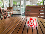 no smoking sign displayed on a table