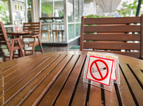 no smoking sign displayed on a table - 63819837