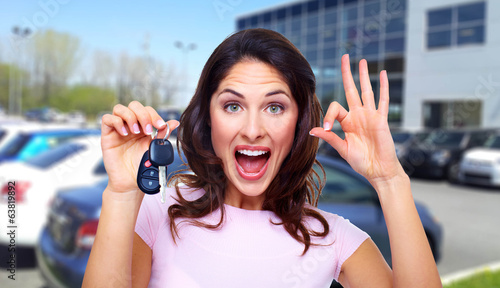 canvas print picture Beautiful woman with a car key.
