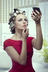 makeup girl with hair rollers